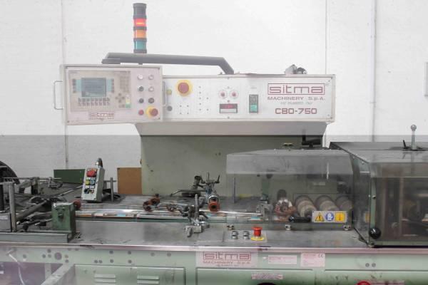 particolare macchinario per confezionamento cataloghi cartacei